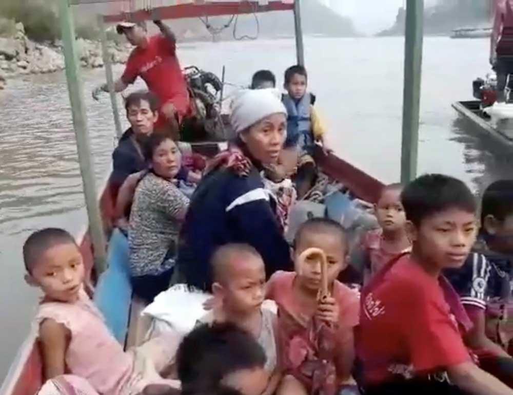 Karen refugees cross the Salween River to Mae Hong Son, Thailand. (Reuters)
