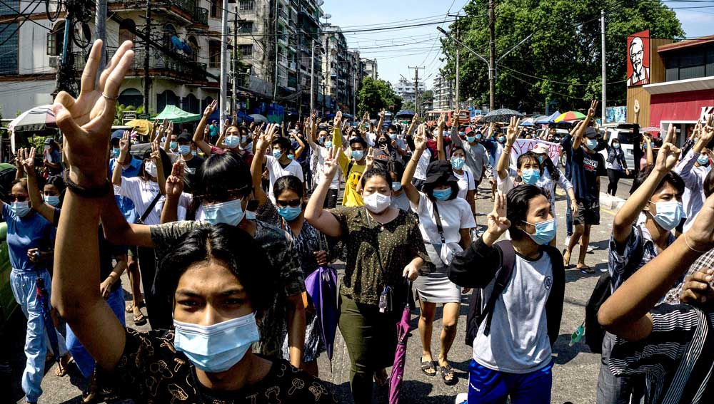 Protesters make the three-finger salute during a demonstration against the military coup in Yangon. (AFP)