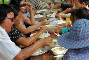 Victims of acid attacks eat their lunch at the Cambodian Acid Survivors Charity near Phnom Penh, Sept. 29, 2010.