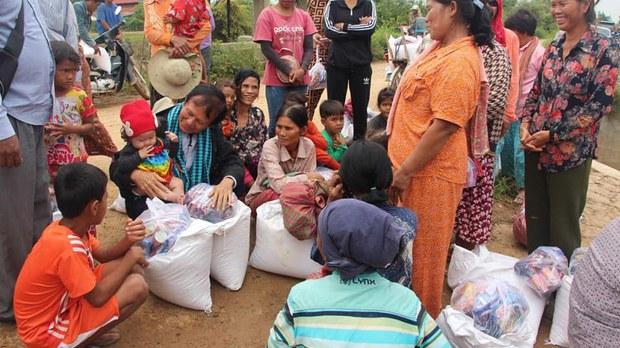 cambodia-kem-sokah-distributes-aid-baby-oct-2020-crop.jpg