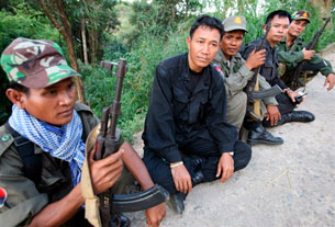 PREAH VIHEAR, Cambodia: Cambodian soldiers sit with captured Thai soldiers near the Preah Vihear temple, 15 October 2008. AFP