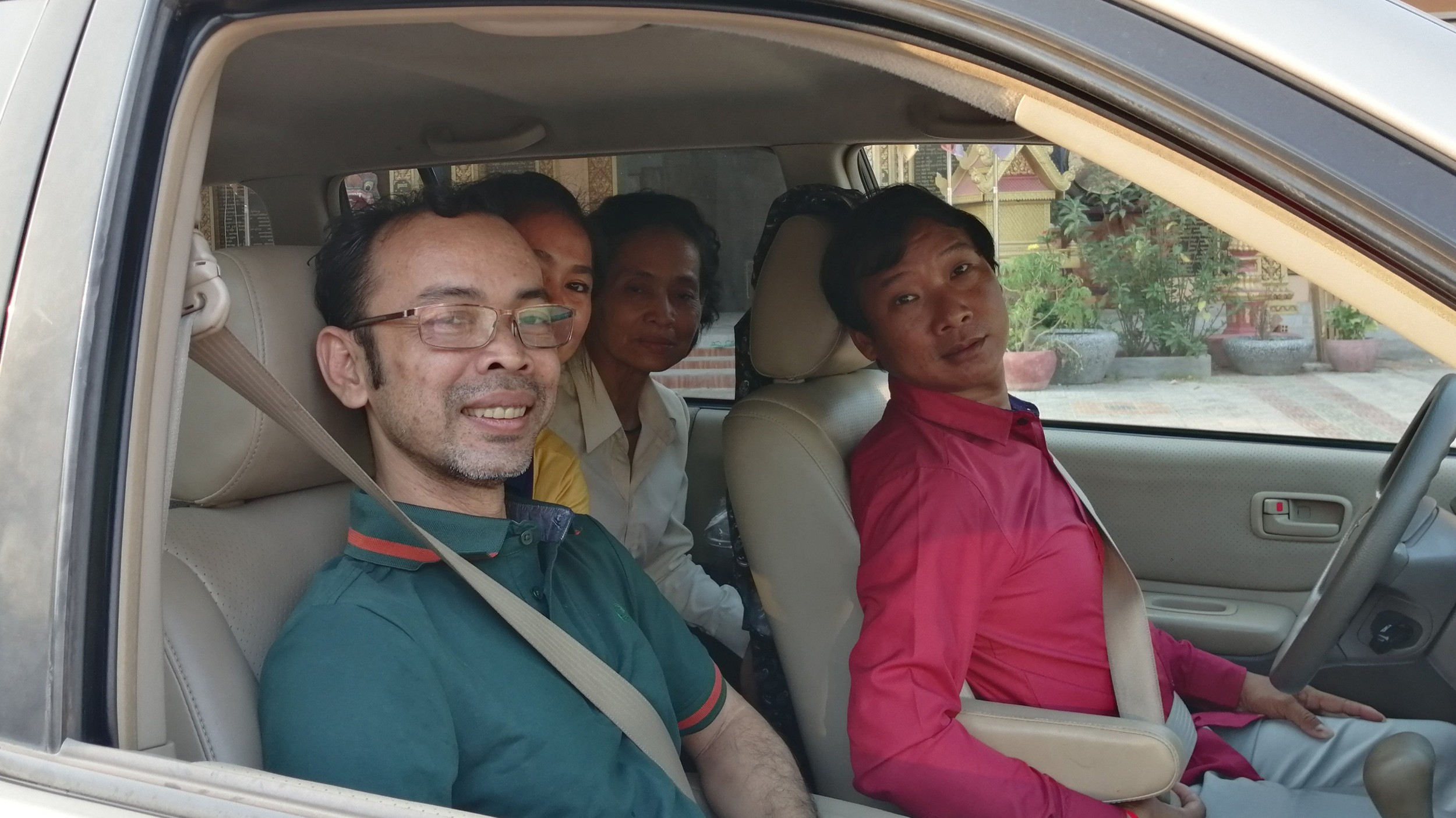 Mai Hong Sreang (far left) prepares to visit a pagoda to receive a blessing following his release from prison, April 3, 2020. Credit: RFA