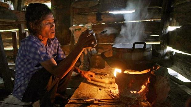 cambodia-villager-cooking-nov22-2012.jpg