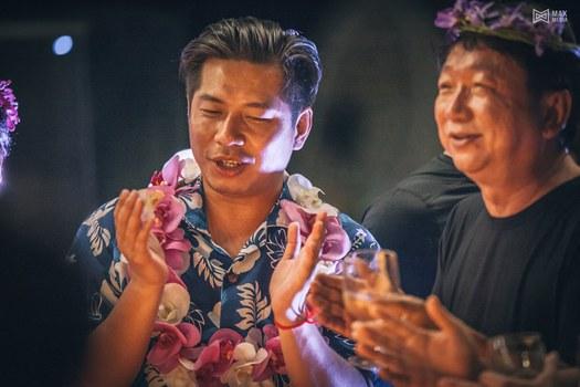 Rithy Samnang, left, and Xu Aimin have fun at the beach birthday party Samnang threw for himself on the island of Koh Smach. Credit: MAX Media