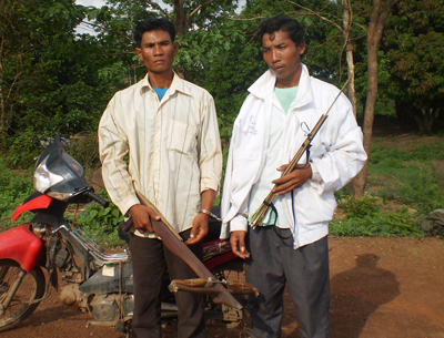 Residents of Broma village hold homemade weapons in an undated photo. Credit: RFA