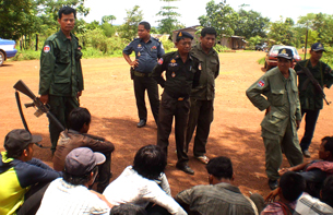 Military police round up residents of Broma village, May 16, 2012.
