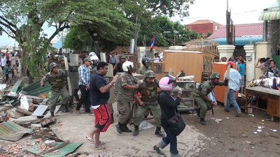 Police charge protesters during a clash at Boeung Kak Lake in Phnom Penh, Sept. 16, 2011.