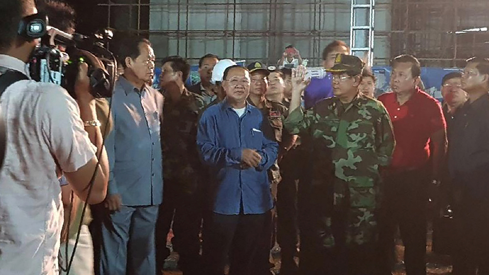 Cambodia's Prime Minister Hun Sen, third from right, visits the site of a building collapse in Sihanoukville, June 23, 2019. Credit: Preah Sihanouk provincial authorities via AP