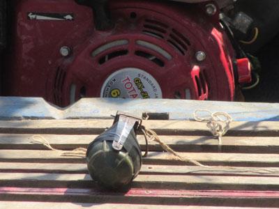 A grenade tied to activist Kuy Saroeun's boat in Siem Reap province, Feb. 6, 2015. Credit: RFA