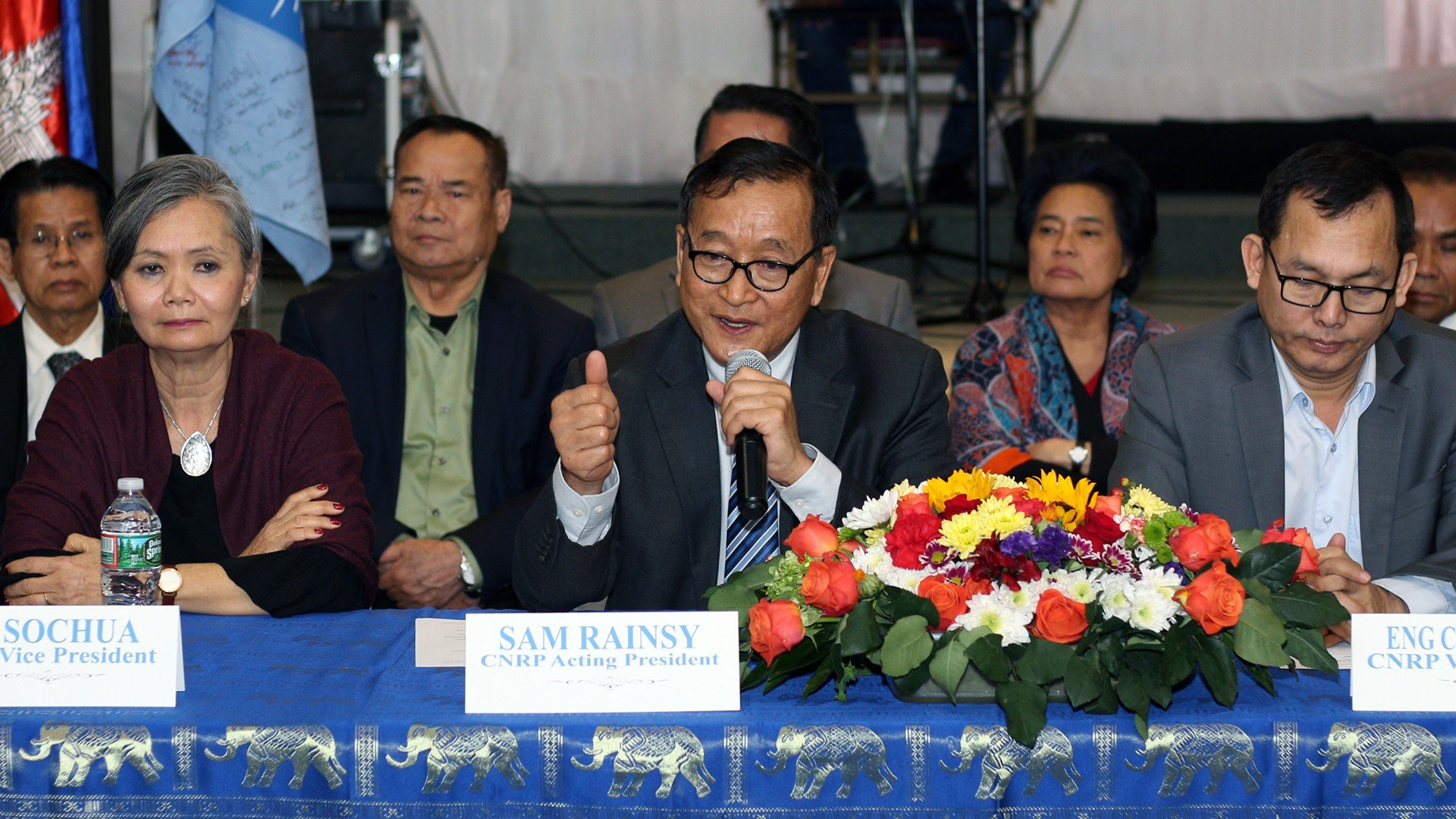 Sam Rainsy (C), Mu Sochua (L), and Eng Chhay Eang (R) speak to reporters during a press conference in the U.S., March 17, 2019.