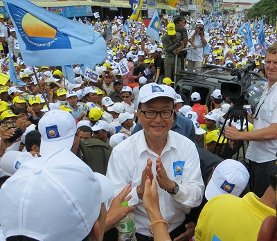 Sam Rainsy greets supporters at a Cambodia National Rescue Party rally in Kompong Cham, July 26, 2013. Photo credit: RFA.