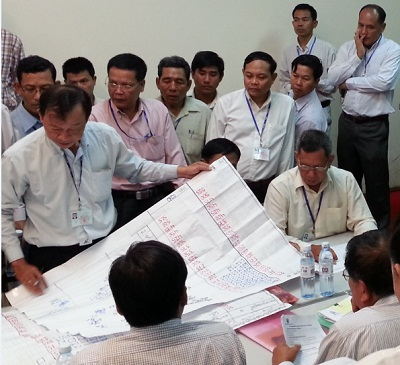 NEC officials show Battambang ballot records to reporters and members of the Constitutional Council and the opposition at the Ministry of the Interior compound in Phnom Penh, Aug. 28, 2013. Photo credit: RFA.