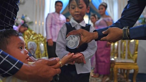 cambodia-hand-sanitizer-wedding-party-march-2020.jpg