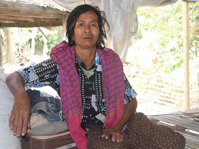 Ut Troeuk sits in her home in Mesang village in southeastern Cambodia's Prey Veng province, Jan. 29, 2016. Credit: RFA