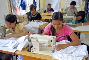 A worker sews at a garment factory in Sihanoukville province, Sept. 9, 2009.