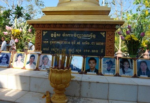 Portraits of the victims in the 1997 grenade attack on display at a memorial in Phnom Penh.