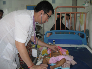 A child is being treated in a referral hospital in Takeo province, July 17, 2012.