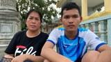 Cambodian activist Prum Chantha (L) and her son, Kak Sovannchhay, sit at a Buddhist temple near Prey Sar Prison in Phnom Penh, Oct. 6, 2020.