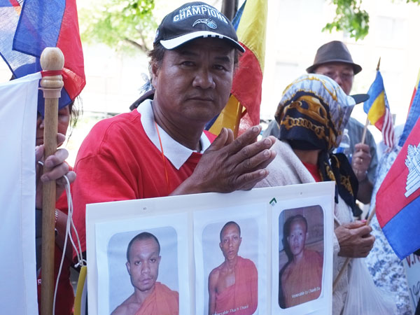 A supporter marks the 64th anniversary of the loss of Khmer Krom land at the Vietnamese Embassy in Washington, June 4, 2013.