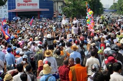 CNRP leaders address Labor Day demonstrators in Phnom Penh on May 1, 2014. Photo credit: RFA.
