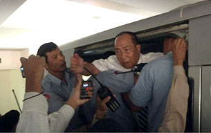 Mam Sonando is escorted into a prison van after his verdict at the Phnom Penh municipal court on Oct. 1, 2012.
