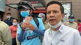 CNRP activist Pen Chan Sangkream (R) participates in a protest outside the municipal courthouse in Cambodia's capital Phnom Penh in an undated photo.