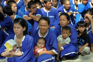 Prison inmates with their children await food donations at Prey Sar Prison in Phnom Penh, June 1, 2010.