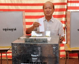 Prince Norodom Ranariddh casts his vote in commune-level elections at a polling booth in Phnom Penh, June 3, 2012.
