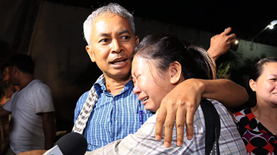 Yi Sokan embraces his daughter in Phnom Penh after his release from prison, June 29, 2017. Credit: RFA