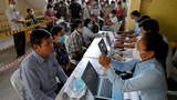 People register as they wait to receive coronavirus vaccines at a hospital in Phnom Penh, March 22, 2021.