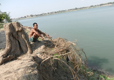 A man by the Mekong riverbank in Tboung Khmum district, central Cambodia's Kampong Cham, March 15, 2012.