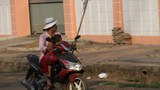 cambodia-sick-daughter-moped-roka-march-2015-1000.jpg