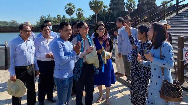Kem Sokha (C, blue scarf) meets with locals in Siem Reap province, July 19, 2020.