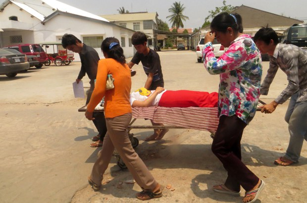 cambodia-garment-worker-faints-june30-2015.jpg