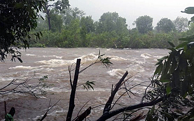 Floodwaters stream through southern Cambodia's Kampot province, Sept. 17, 2015. Credit: RFA