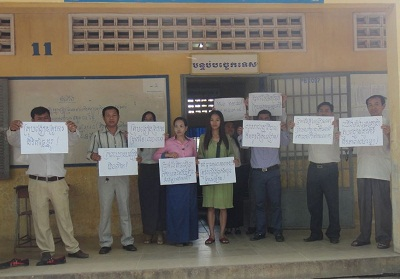 Striking Cambodian teachers display signs calling for higher salaries, Jan. 8, 2014.