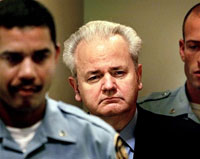 Former Yugoslav President Slobodan Milosevic appears before the court of the International Criminal Tribunal for the former Yugoslavia in The Hague in December 2001. Milosevic was charged with genocide and crimes against humanity. Photo: AFP Photo Reuters PoolL/Paul Vreeker