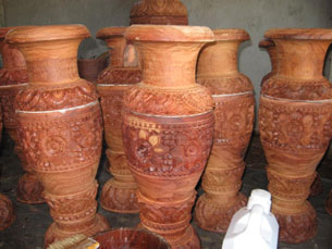 Carved wooden vessels are stored for sale in Prongil village, Aug. 22, 2009. RFA/Mondol Keo