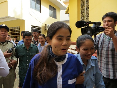 Yorm Bopha is escorted from the Supreme Court hearing, Nov. 22, 2013. Photo credit: RFA.