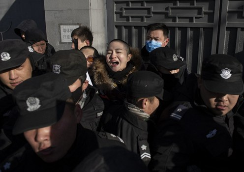 Chinese police surround Li Wenzu, wife of human rights lawyer Wang Quanzhang, outside his trial in Beijing,  Dec. 28, 2018.  Li has applied to run in elections for the Beijing Municipal People's Congress in November.