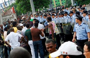 In a previous protest on July 15, 2009, Guangzhou police face off with Africans protesting after a Nigerian man died trying escape a visa check.