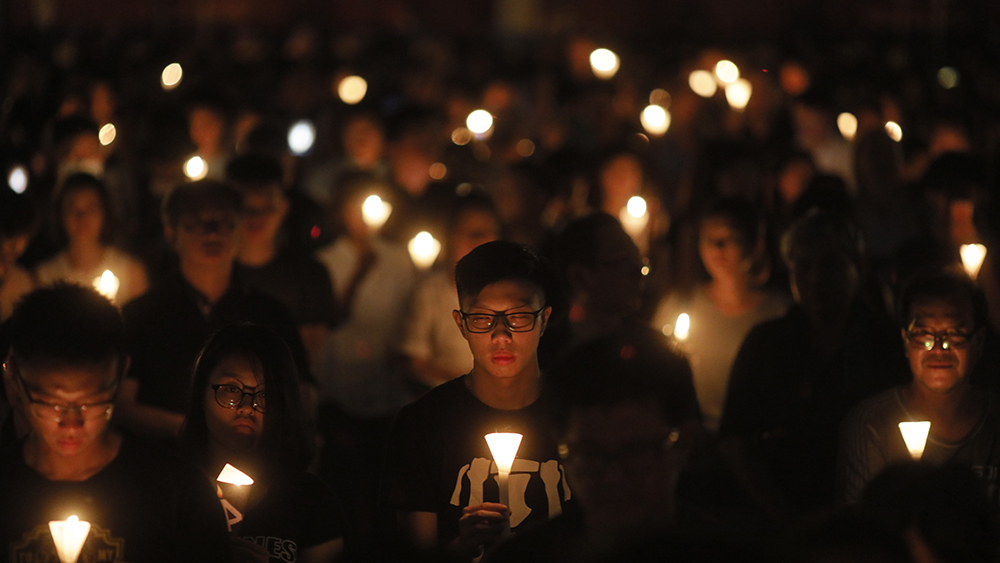 Tens of thousands of people attend an annual candlelight vigil at Hong Kong's Victoria Park, June 4, 2018. Credit: AP Photo