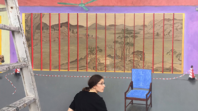 Hu Jiamin's wife, Marine Brossard, prepares her husband's painting for exhibition in Shenzhen, in an undated photo. Credit: Free Liu Xiaobo's Twitter feed