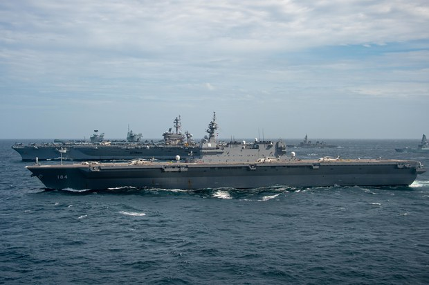 The aircraft carrier USS Carl Vinson and Japanese destroyer JS Kaga sail together during in the Bay of Bengal, Oct. 17, 2021.