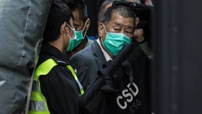 Hong Kong media tycoon Jimmy Lai is escorted to a correctional services van outside the Hong Kong Court of Final Appeal, Feb. 1, 2021.