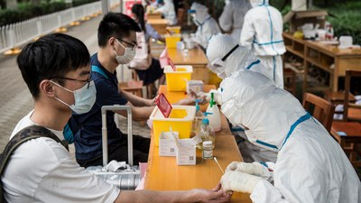 University graduates have  blood samples taken amid the COVID-19 coronavirus pandemic, before entering campus to receive their diplomas at Huazhong University of Science and Technology in Wuhan in China's central Hubei province, June 11, 2020.