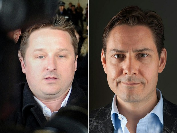 """File photos of businessman Michael Spavor (L) and former diplomat Michael Kovrig, two Canadians imprisoned by China in what critics branded """"hostage diplomacy"""" and sent home on Sept. 24, 2021."""