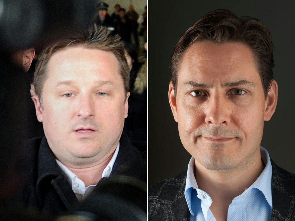 Huawei's Meng, Canada's 'Two Michaels' Freed, Board Planes For Home