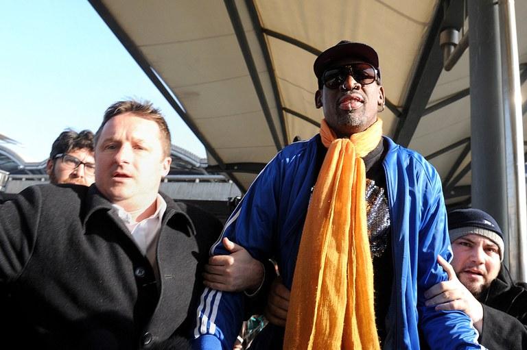Canadian businessman Michael Spavor (L) walks with former U.S. basketball player Dennis Rodman after arriving from North Korea at Beijing International Airport in Beijing, Jan.13, 2014. Credit: AFP