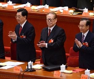 Hu Jintao (l), Jiang Zemin (c), and Wen Jiabao (r) applaud at the closing ceremony of the 18th Party Congress in Beijing, Nov. 14, 2012.